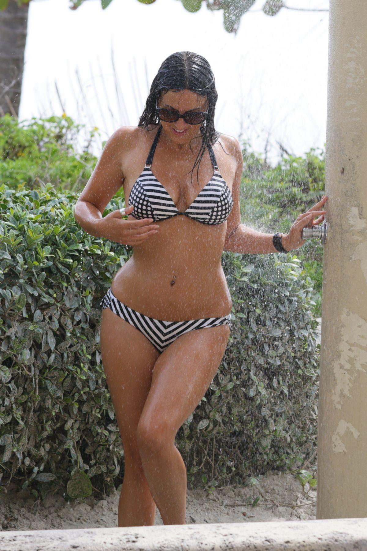 CLAUDIA ROMANI in Bikini Taking a Shower in Miami