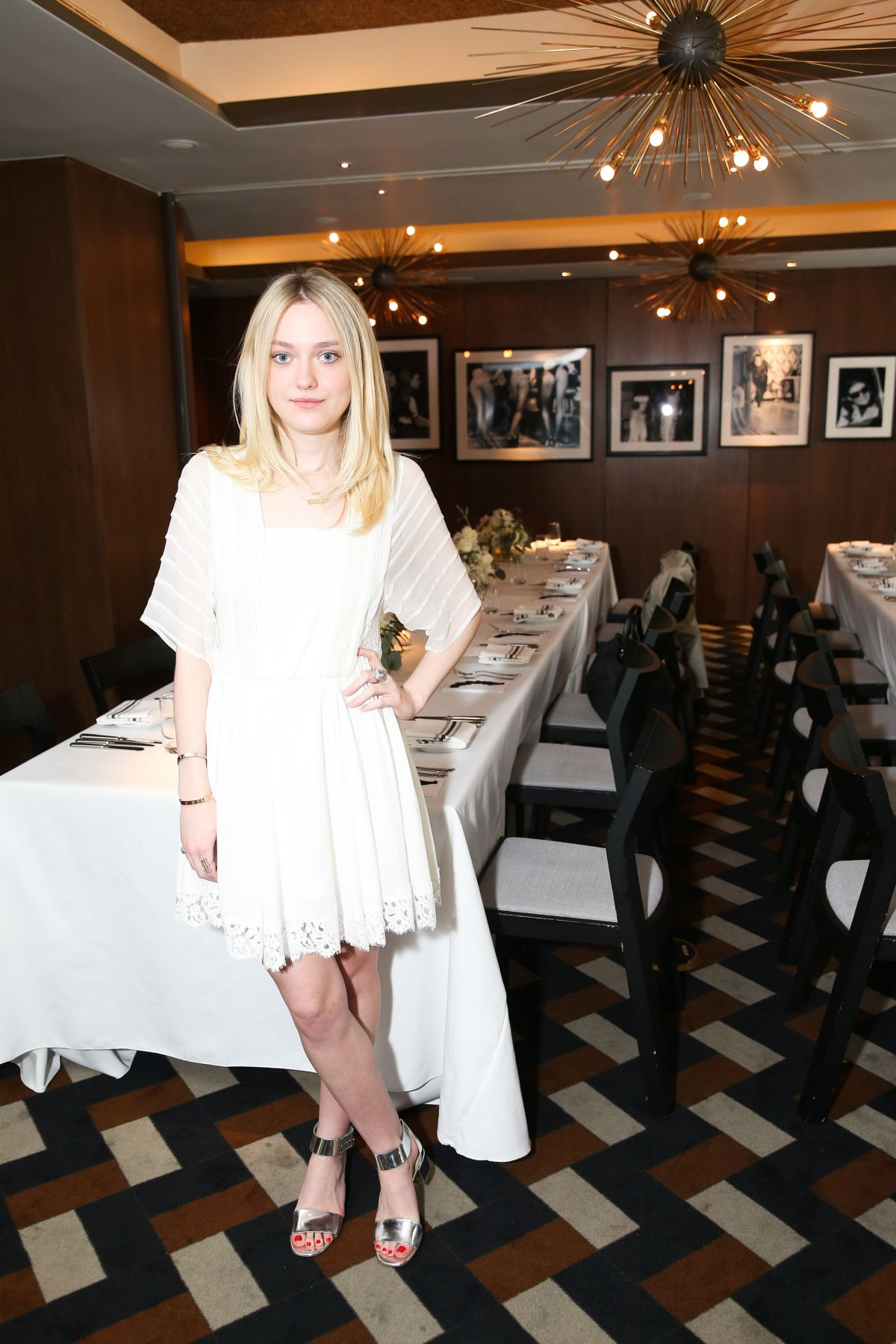 DAKOTA FANNING at Vogue Celebrates AGL Collection in New York