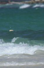 EMILY CAMP in Bikini at a Beach in Cancun