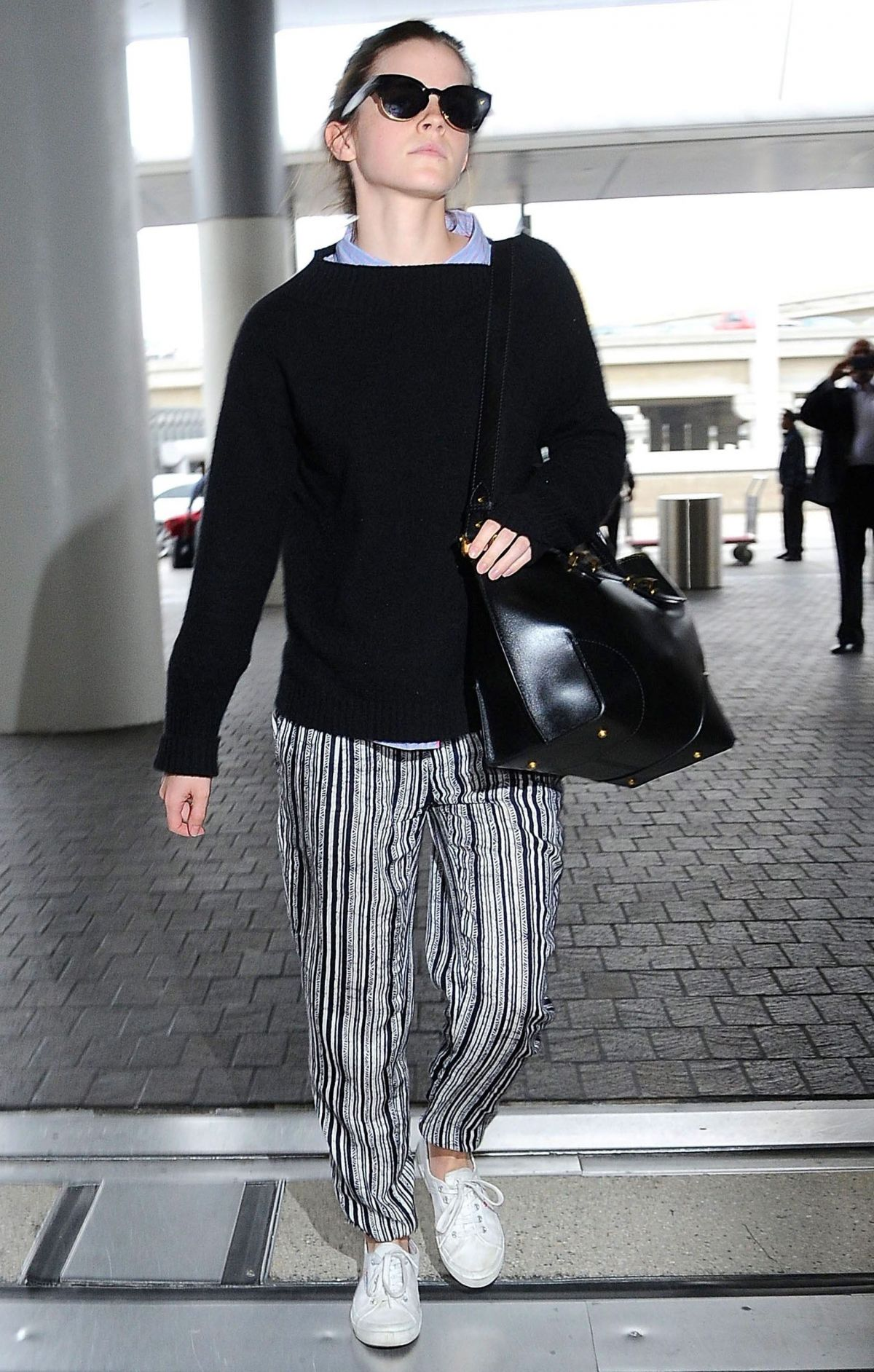 EMMA WATSON at LAX Airport in Los Angeles 04/25/2015
