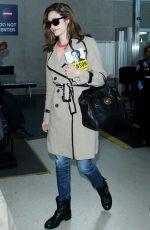 EMMY ROSSUM Arrives at Los Angeles International Airport