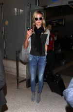 HEIDI KLUM Arrives at LAX Airport in Los Angeles 04/25/2015