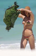 IRINA SHAYK in Bikini on the Beach in Mexico