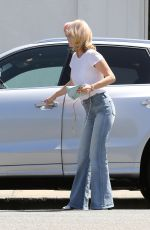 JANUARY JONES in Jeans Out in Beverly Hills