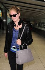 KATE UPTON Arrives at Heathrow Airport 04/25/2015