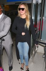 KHLOE KARDASHIAN in Jeans at LAX Airport in Los Angeles