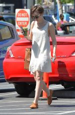LILY COLLINS Arrives at Juice Bar in West Hollywood 04/18/2015