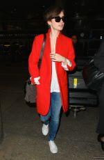 LILY COLLINS Arrives at Los Angeles International Airport