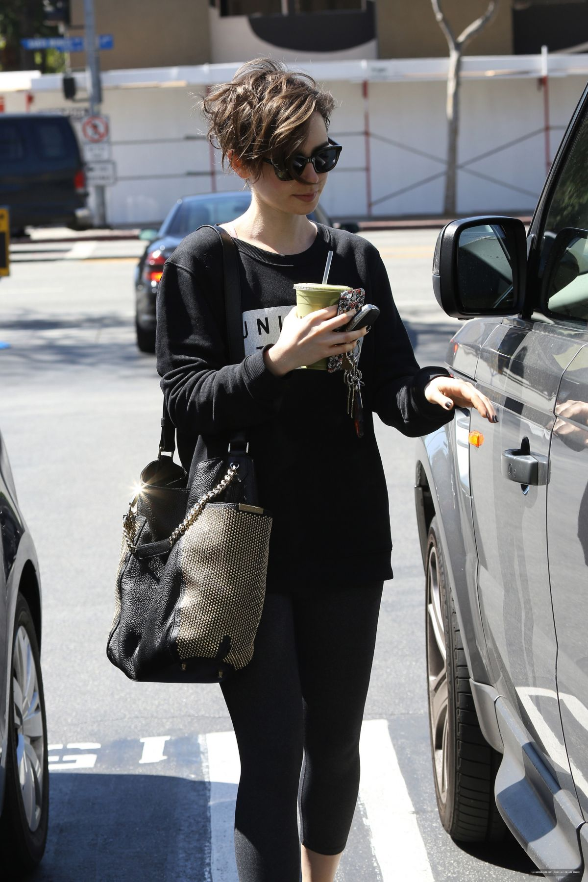 LILY COLLINS at Car Wash of the Star in West Hollywood