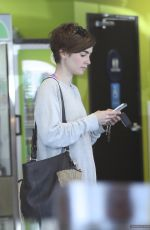 LILY COLLINS at Earth Bar in West Hollywood