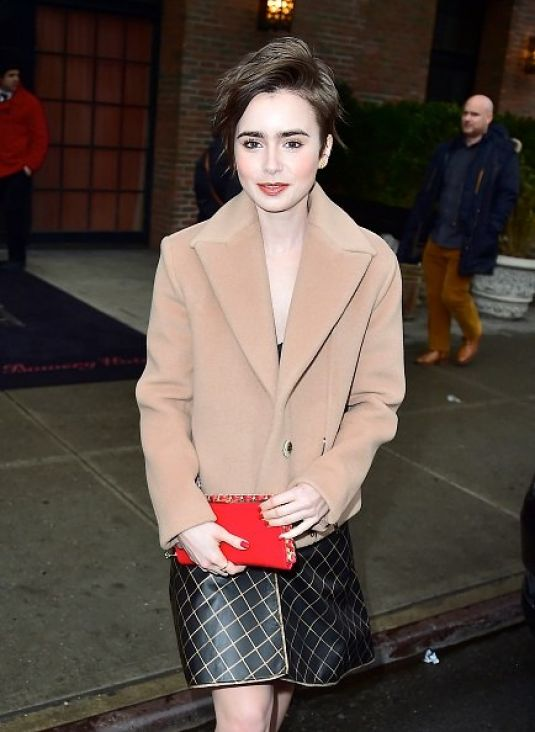 LILY COLLINS Leaves Her New York Hotel