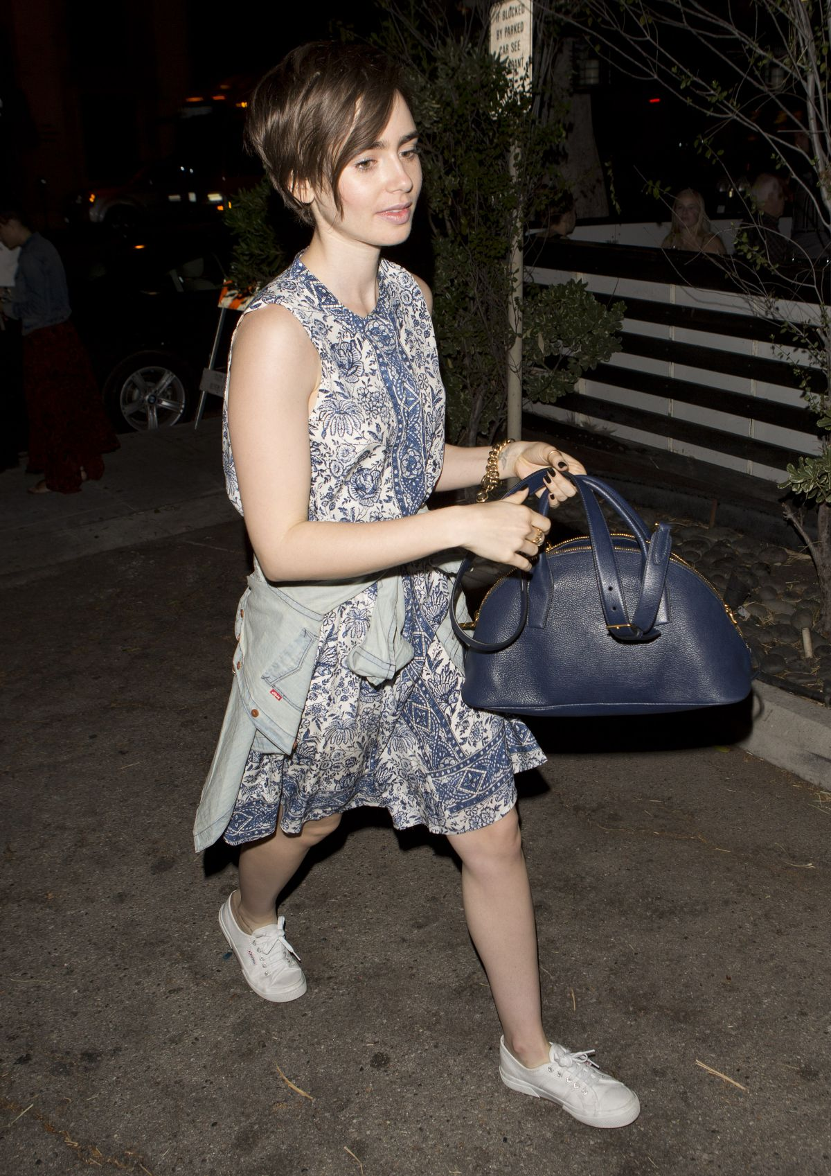 LILY COLLINS Leaves Taste Restaurant in West Hollywood