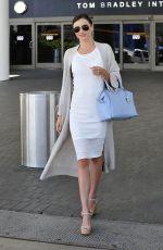 MIRANDA KERR Arrives at Los Angeles International Airport