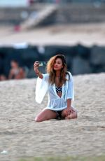 NICOLE SCHERZINGER Taking a Selfie on the Beach in Hawaii