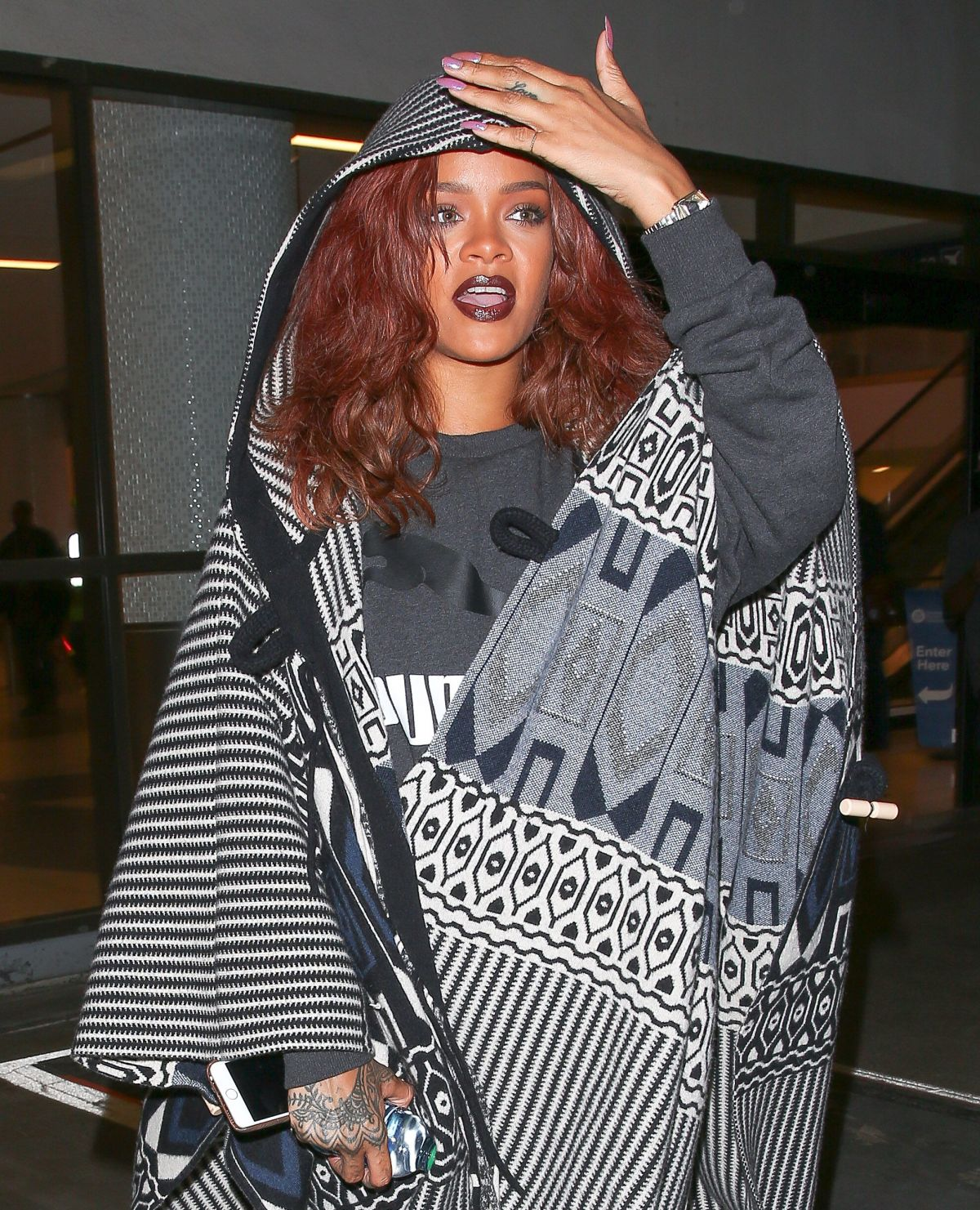 RIHANNA Arrives at LAX Airport in Los Angeles 04/29/2015