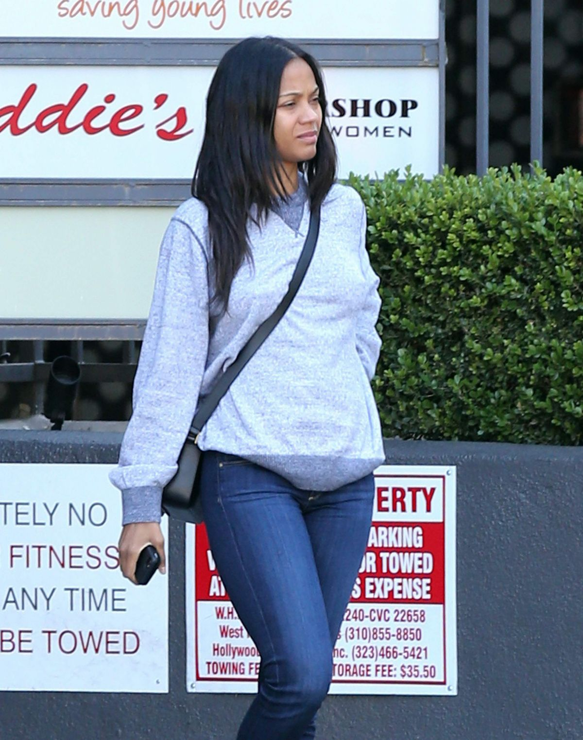 ZOE SALDANA Out and About in Hollywood 04/26/2015