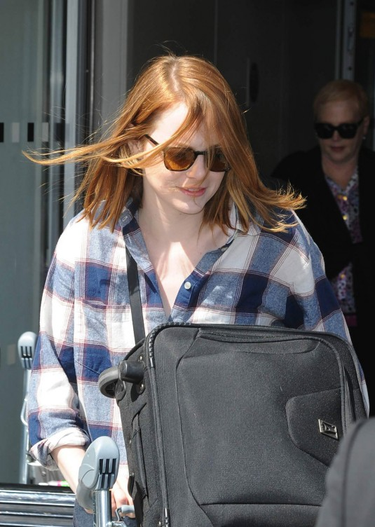 EMMA STONE Arrives at Heathrow Airport in London