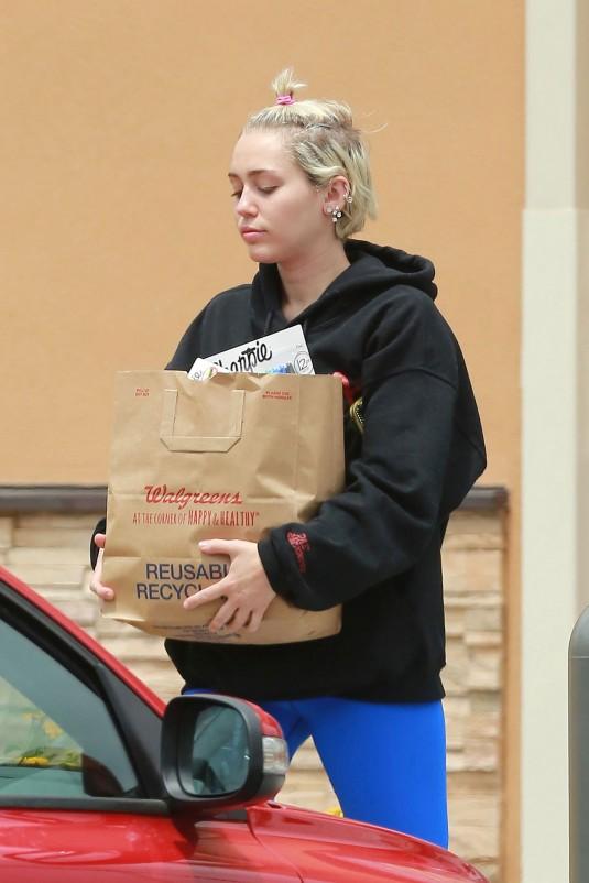 MILEY CYRUS Leaves Walgreens in Studio City