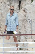 CHARLIZE THERON at Eden Roc Hotel Pool in Cannes