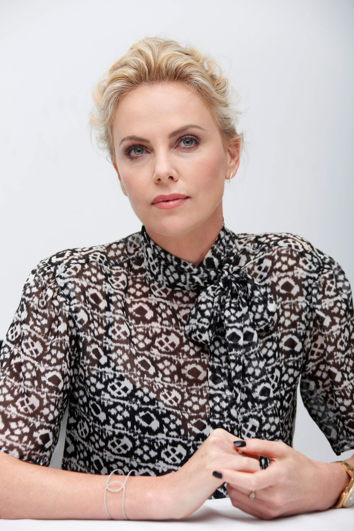 CHARLIZE THERON at Mad Max: Fury Road Press Conference - HawtCelebs ... Charlize Theron