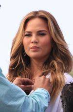 CHRISSY TEIGEN on the Set of Extra in Los Angeles