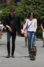 DAKOTA JOHNSON Walks Her Dog Out in New York 05/24/2015