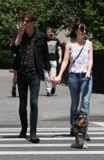 DAKOTA JOHNSON Walks Her Dog Out in New York 05/24/2015