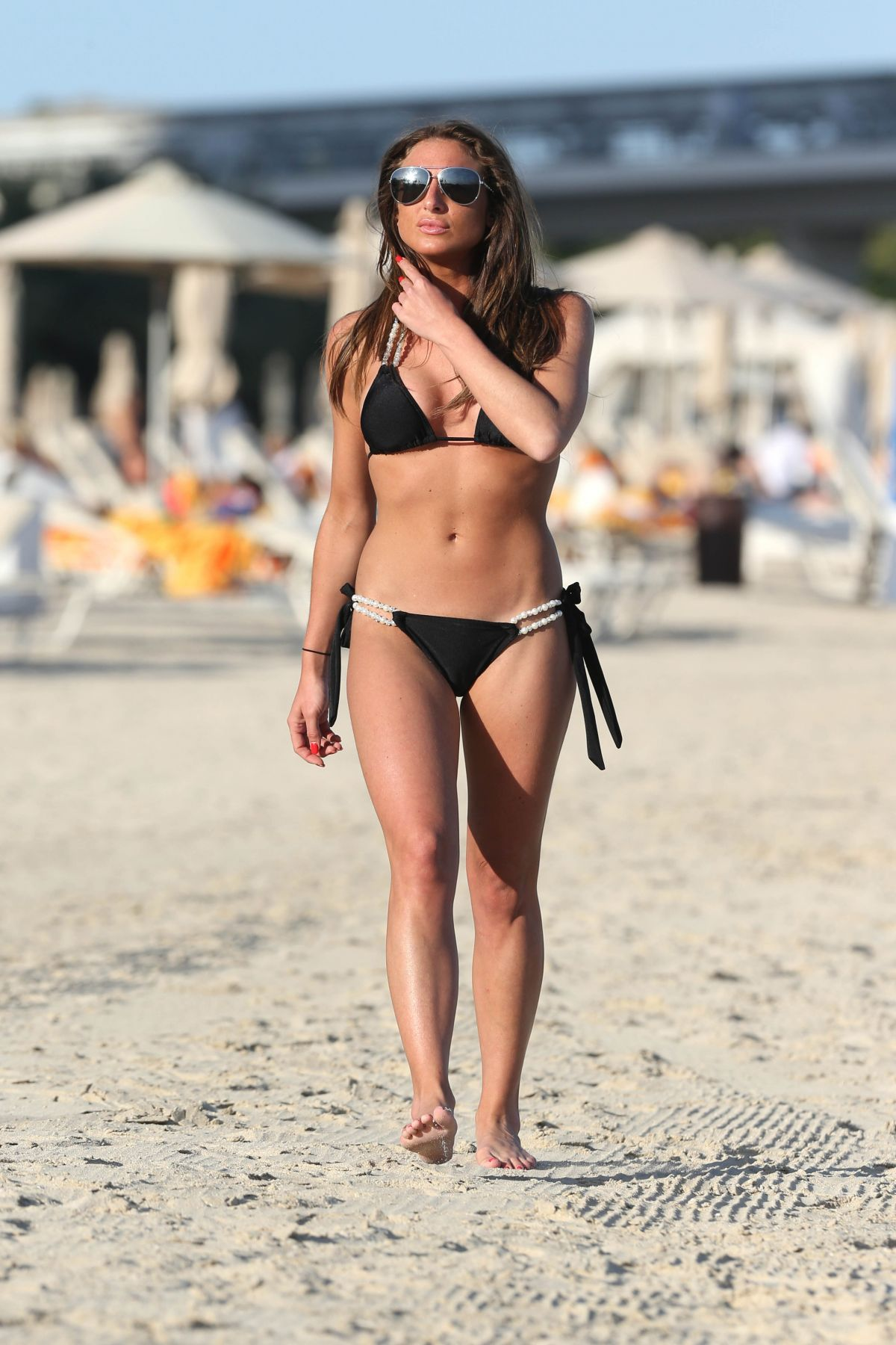 Charlotte mckinney wears skimpy black bikini on malibu beach