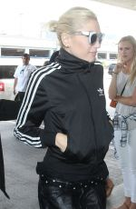 GWEN STEFANI Arrives at LAX Airport in Los Angeles 04/30/2015