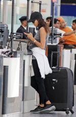 IRINA SHAYK at Heathrrow Airport in London