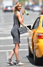 KARLIE KLOSS Getting into a Cab in New York