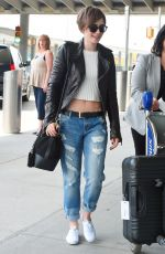 LILY COLLINS in Ripped Jeans at JFK Airport 05/05/2015
