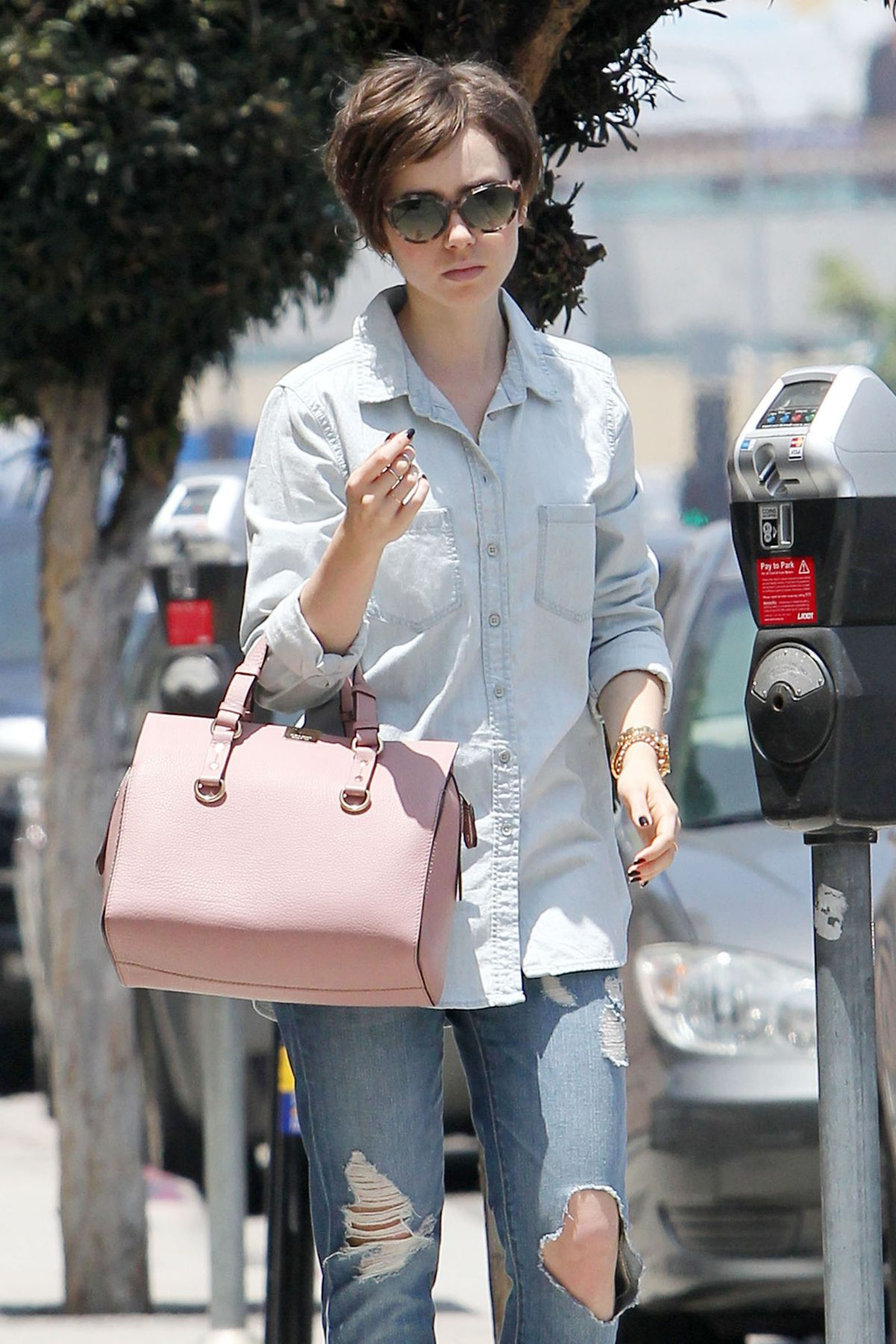 LILY COLLINS in Ripped Jeans Heading to a Nail Salon in West Hollywood 05/29/2015
