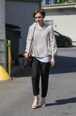 LILY COLLINS Leaves a Hair Salon in West Hollywood 05/15/2015