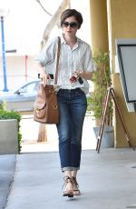 LILY COLLINS Leaves Earthbar in West Hollywood 05/11/2015