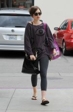 LILY COLLINS Out Shopping in Los Angeles 05/06/2015