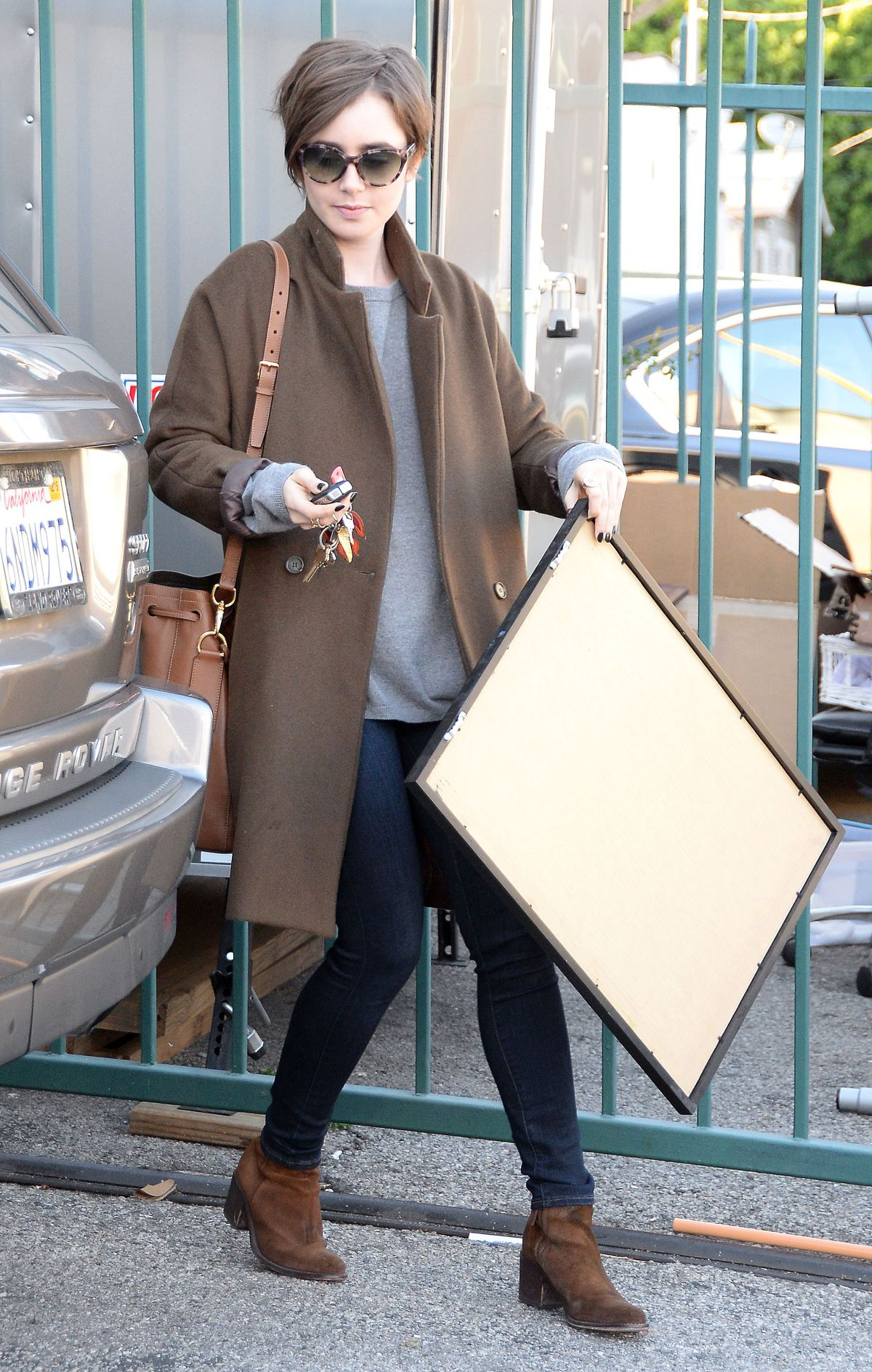 LILY COLLINS Out Shopping in Los Angeles 05/15/2015