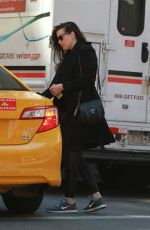 LIV TYLER Hailing for Taxi in New York