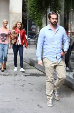 MICHELLE HUNZIKER and Tomaso Trussardi Drive Their Porsche Out in Milan