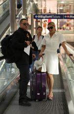 MICHELLE HUNZIKER Arrives at Railway Station in Milan 05/25/2015