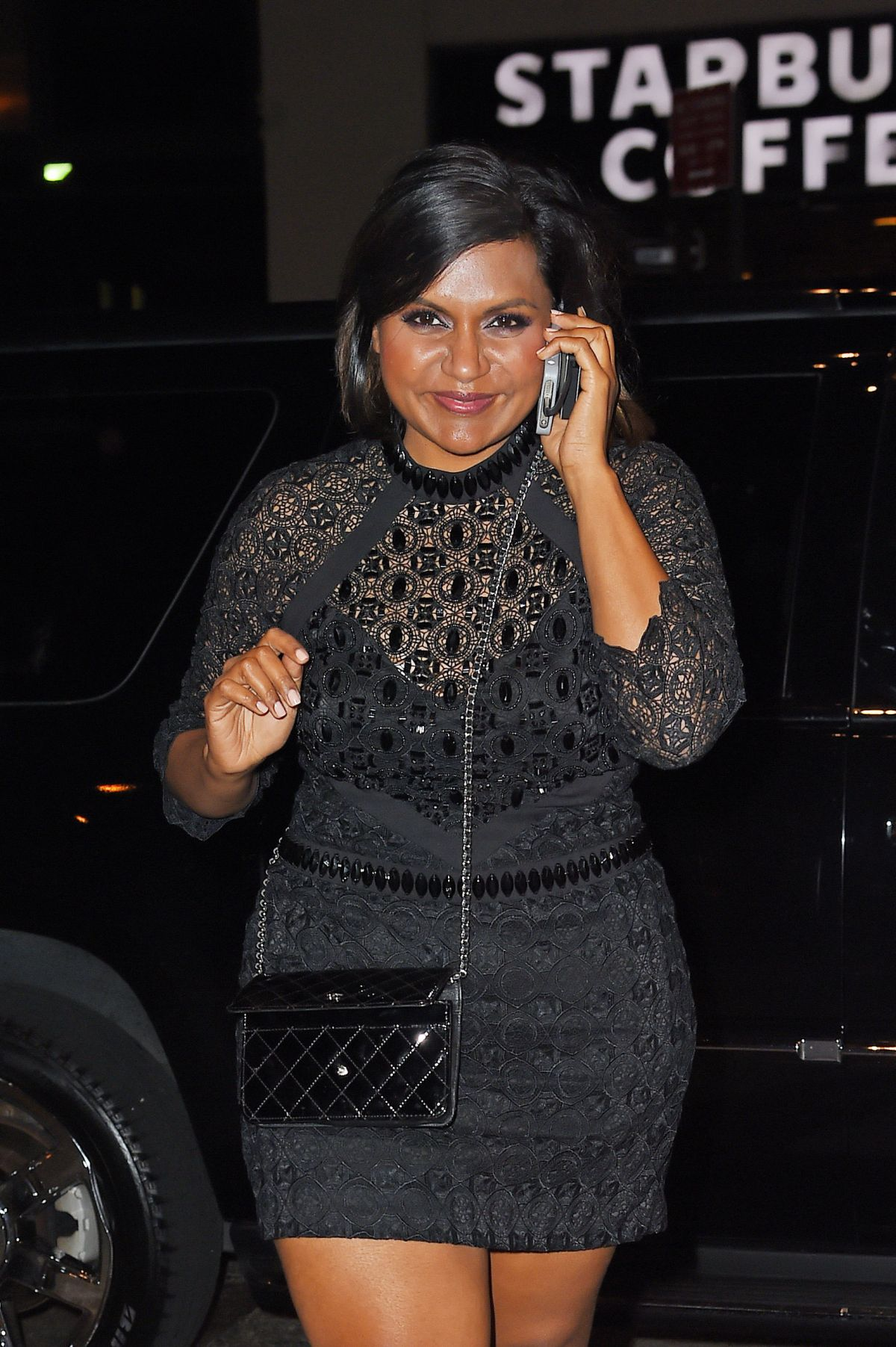 MINDY KALING Out and About in Soho 05/29/2015