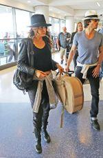 NIKKI REED Arrives at Los Angeles International Airport 05/19/2015