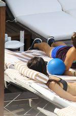 NIKKI REED at a Pool in Rio De Janeiro
