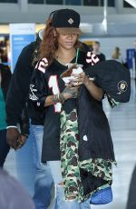RIHANNA in Ripped Jeans at JFK Airport 04/30/2015