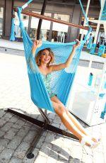 SARAH HYLAND at Hawaiian Tropic Escape Event in New York