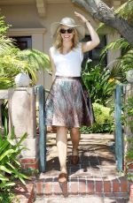 ALOISE MUMFORD Leaves a Clothing Store in Beverly Hills