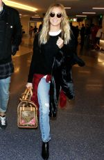ASHLEY TISDALE Arrives at LAX Airport in Los Angeles 06/16/2015