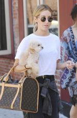 ASHLEY TISDALE With Her Dog Out in Soho 06/13/2015