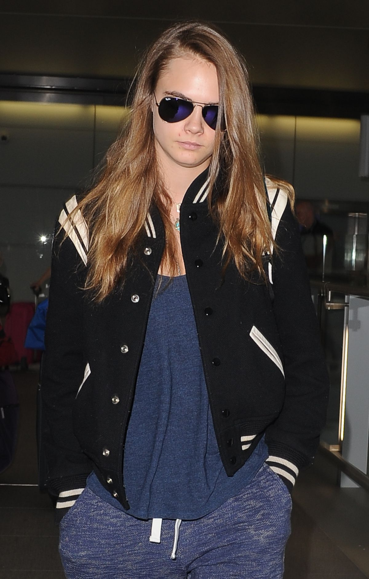 CARA DELEVINGNE at Heatrow Airport in London 06/29/2015