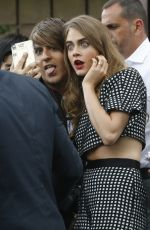 CARA DELEVINGNE Greeting Fans at Her Hotel in Madrid 06/15/2015